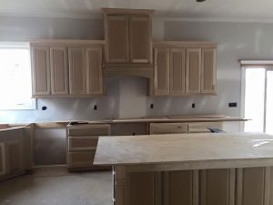 What Comes First – The Cabinets or the Flooring?